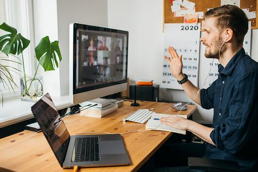 Man attending virtual conference online