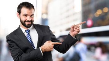 man-pointing-sales-marketing-business-suit