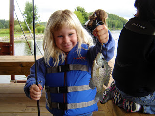 girl shows off bluegill catch