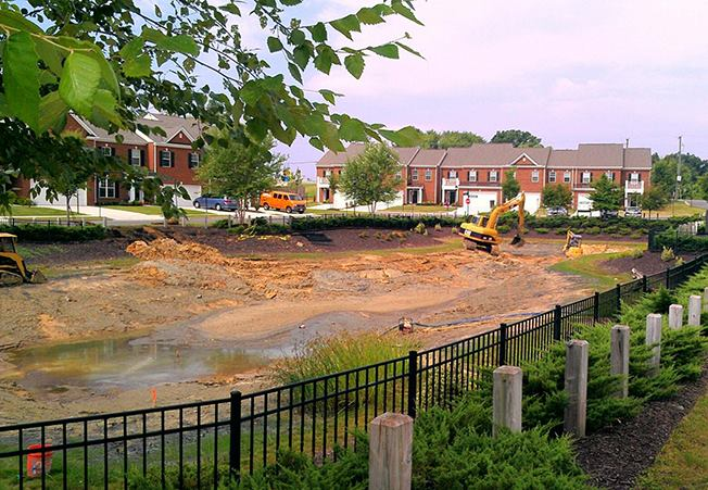 dredging a community pond