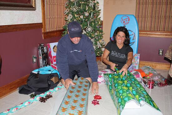 Becky and Chris Wrapping HOLiday Cheer Gifts