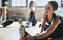 a smiling woman doing dynamic stretches