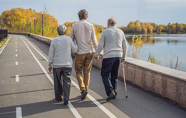 someone with parkinsons walking on a bridge