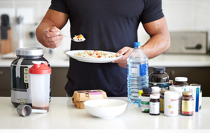 man boosting testosterone with foods and supplements