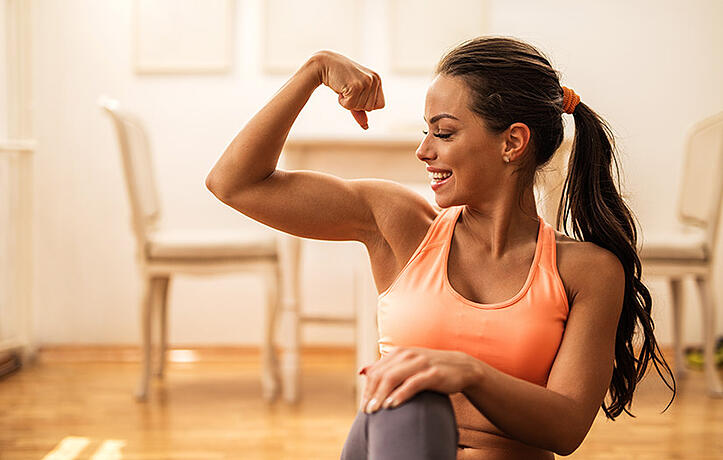 a woman flexing her bicep