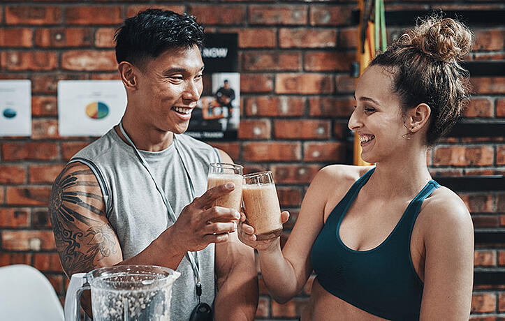 a nutrition coach and a client sharing a healthy smoothie