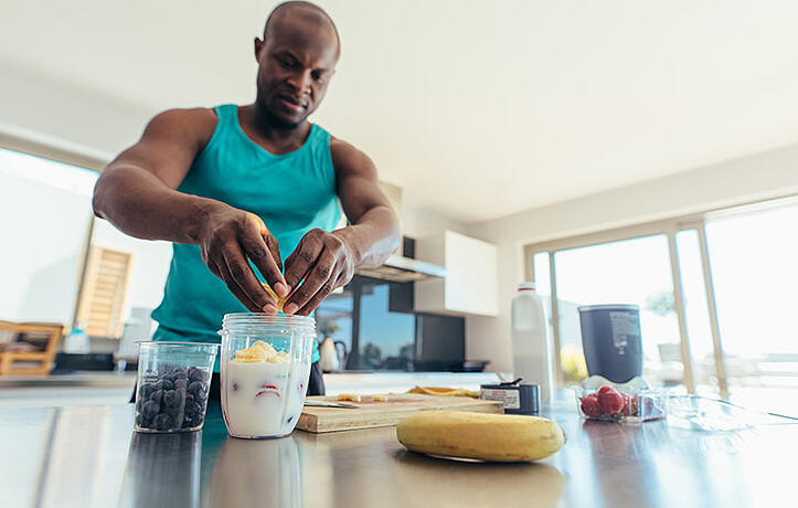man making a smoothie before a workout