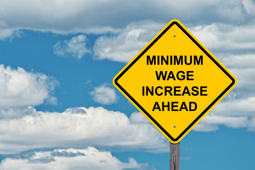 traffic sign stating minimum wage inrease ahead
