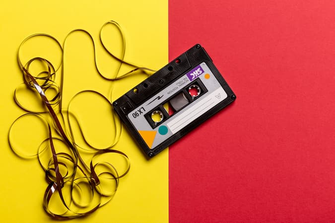 Cassette Tape Against Yellow and Red Background