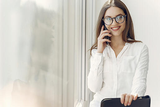 Business Woman Smiling While Talking on The Phone