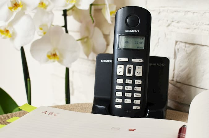 Phone and Voicemail Machine on Desk