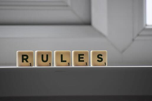 Rules Spelled Out With Wooden Cubes