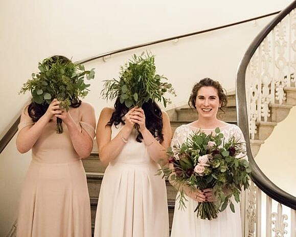 Bride with her bridal party and beautiful bouquets