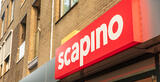 A sign with the Scapino logotype, written in white on a red background, on the face of a building.
