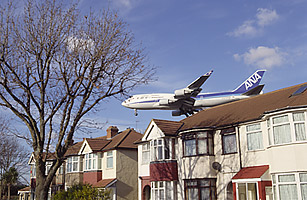 airplane in residential neighborhood