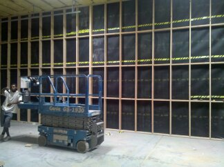 Acoustiblok soundproofing material installed in an industrial setting