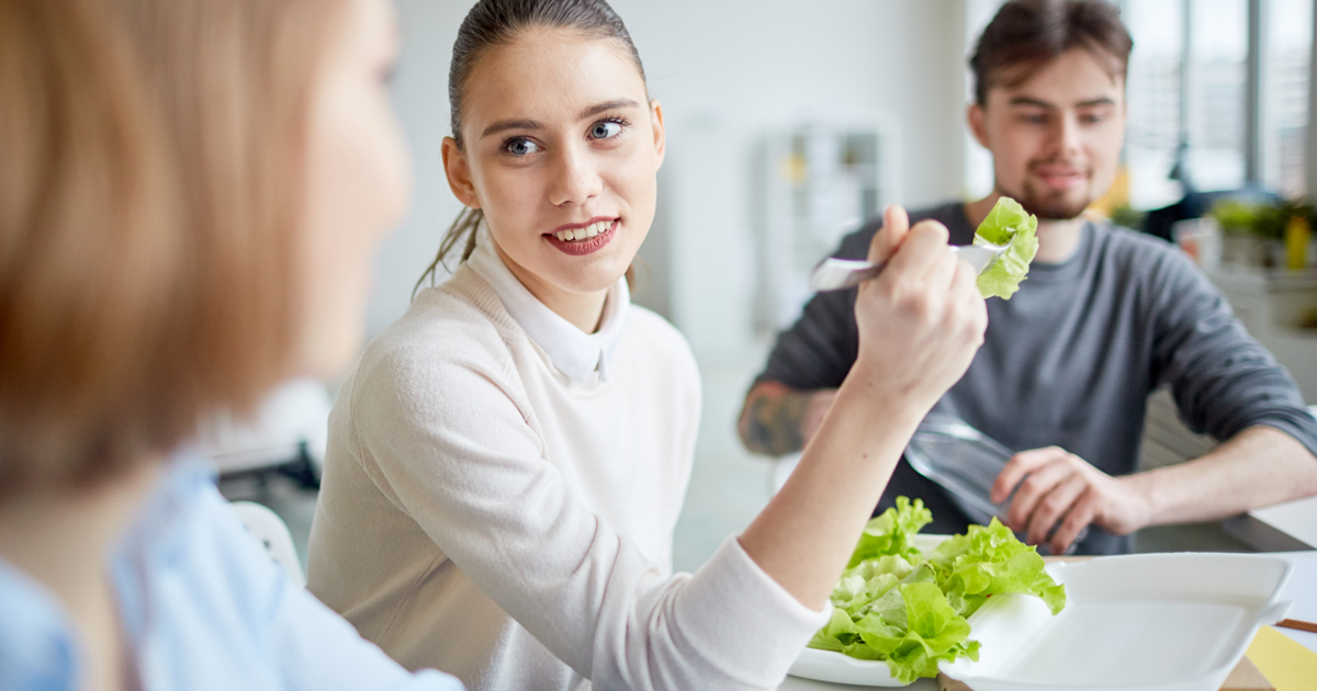 Woman eating lunch provided by employer