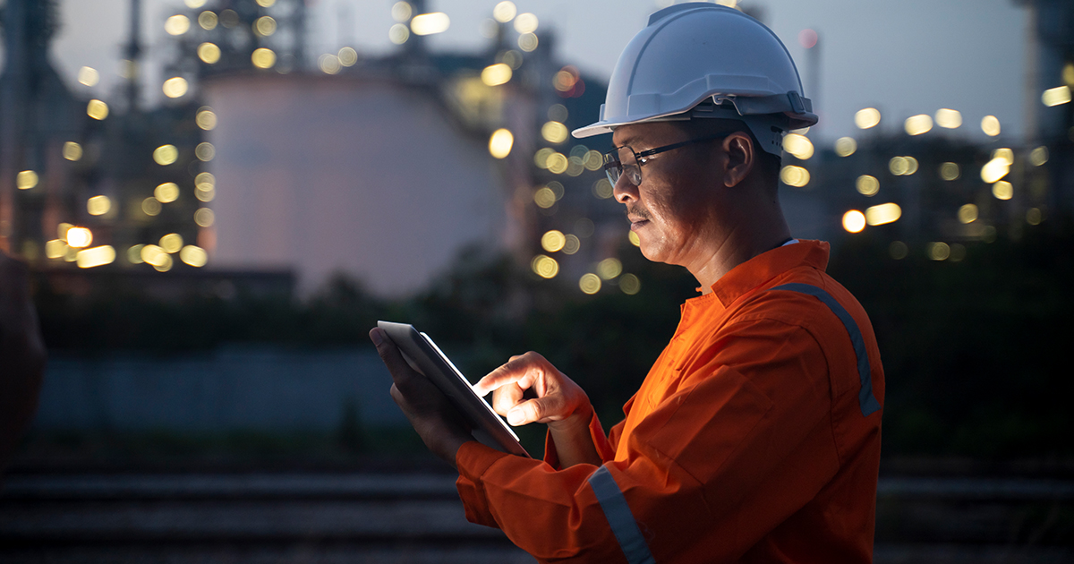 Someone in the oilfield looking at a tablet