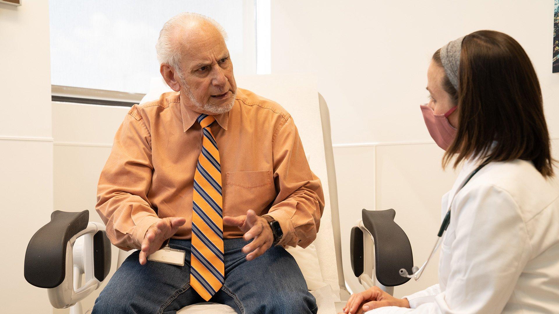 older-elderly-patient-talking-to-provider-mask
