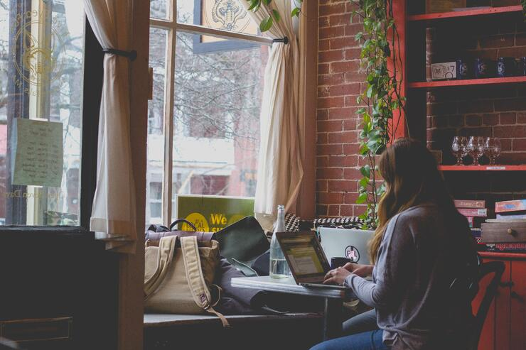 Woman typing on a computer. Photo by Bonnie Kittle on Unsplash