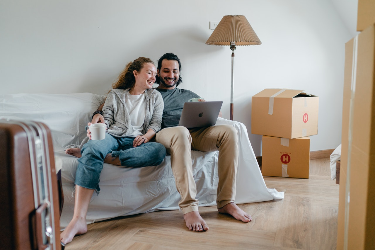 happy-couple-spending-time-together-on-sofa-after-moving-4245928