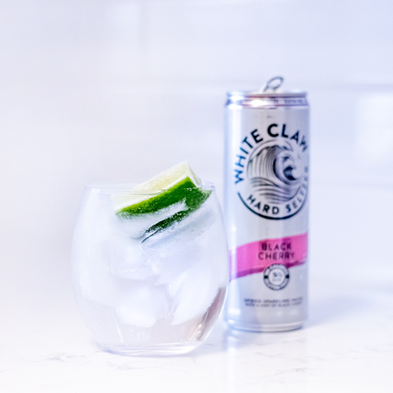 White Claw can next to a glass