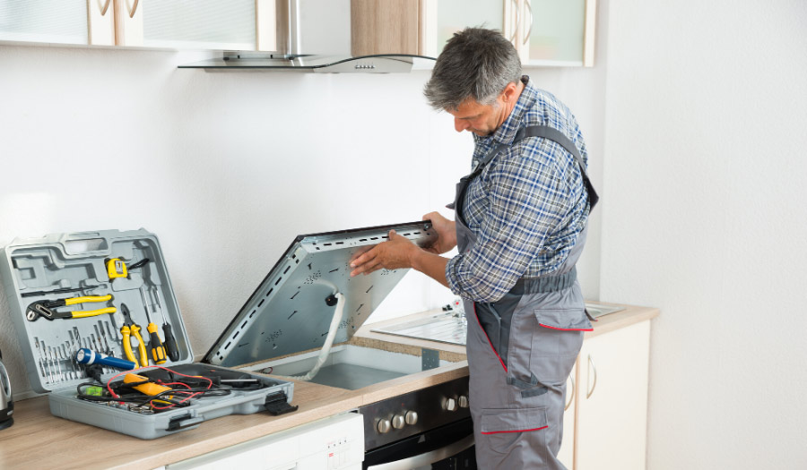 Man fixing appliances