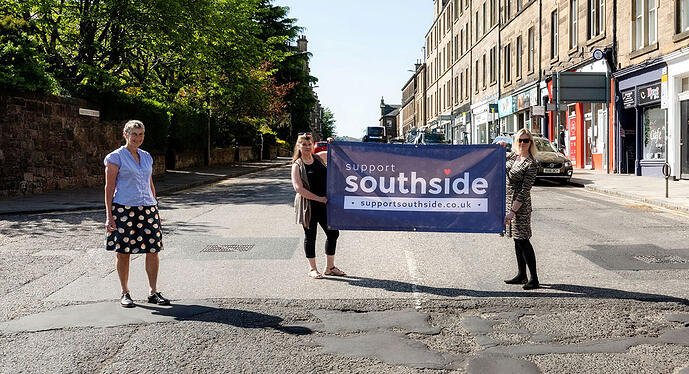 Photo of Support Southside team with banner on Morningside Road during Lockdown 2020