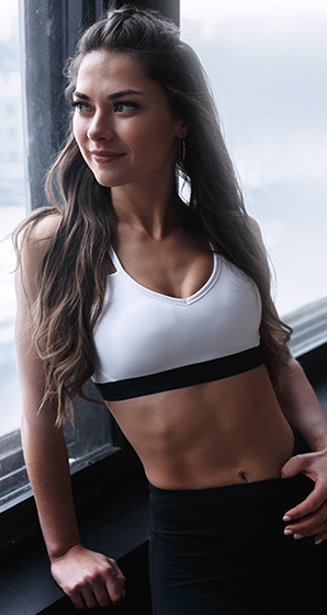 Fit woman with defined abs you can get yourself with CoolTone