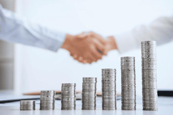 Money Funding Handshake Agreement Stock Photo