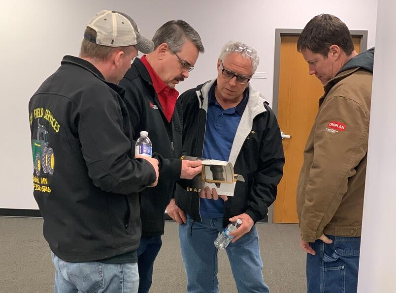 Kevin Wolter speaks with some customers