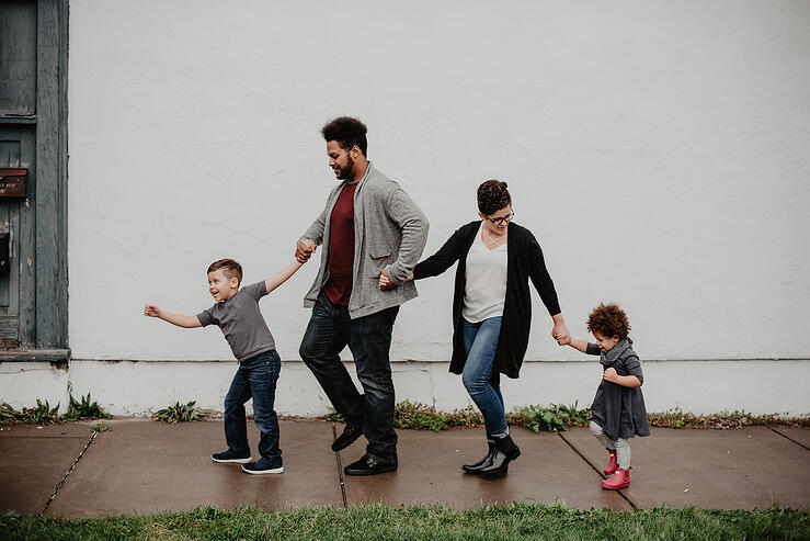 Family walking together holding hands