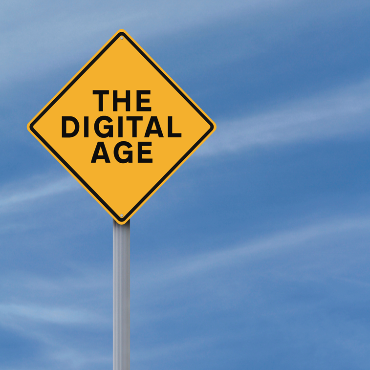 a road sign says 'the digital age'