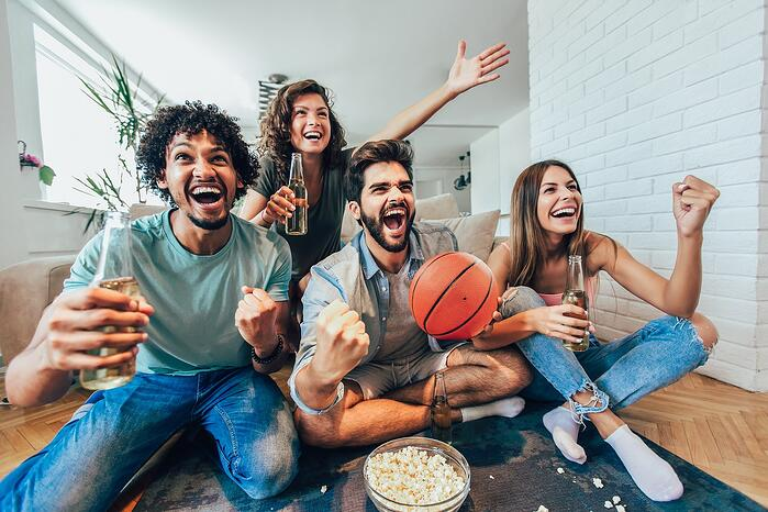 Sports fans cheer for their basketball team