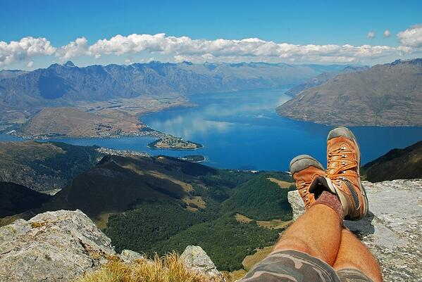 sitting above queenstown view of feet and the lake