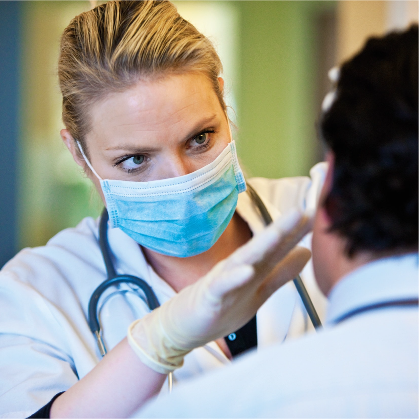 A Bunzl supplied medical face mask, stethoscope and latex gloves used in the workplace-min