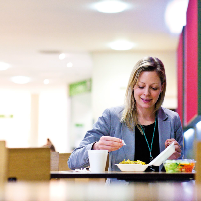 A diner eats her lunch from take away containers and packaging supplied by Bunzl 2 (1)