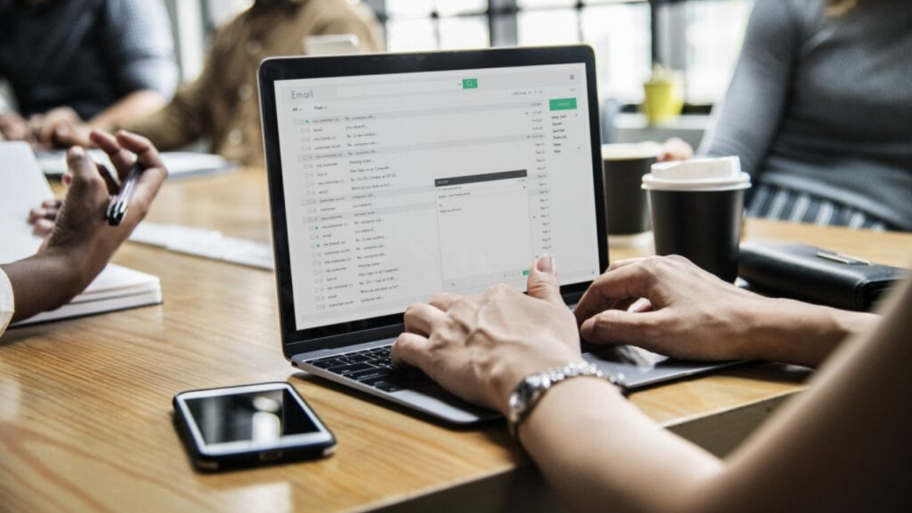 email-marketing-laptop-smartphone-hands