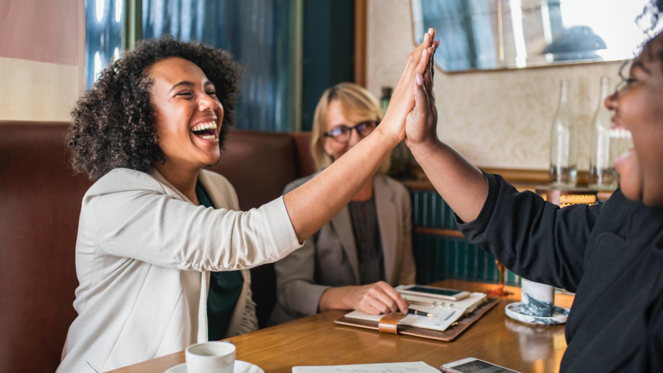 social-media-investment-high-five-women