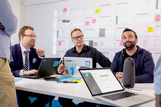People discussing in a UX meeting