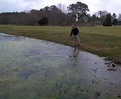 Marc_Treating_Algae_at_Bayside_GC_Employees_Working_in_the_Field_Selbyville_DE_Greg_April_2014_9_e