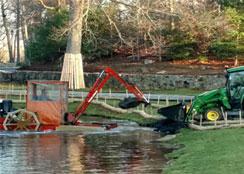 Hydro-Rake Dumping Debris On Shore