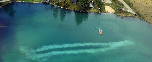 Aerial of Alum Application on Large Lake