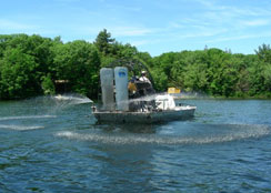 Alum Barge Applying Environmentally Sensitive Product