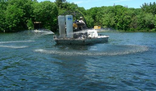 Alum Barge Applying Environmentally Sensitive Product