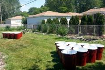 Giant beer pong at an outdoor bbq event