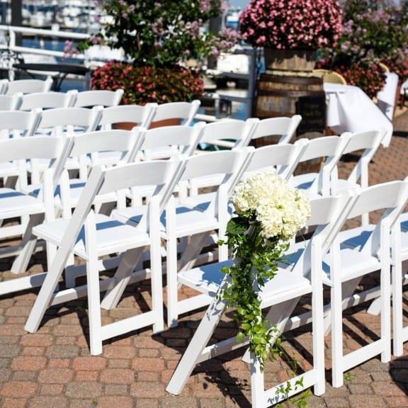 Beautiful chiavari chairs at an outdoor wedding