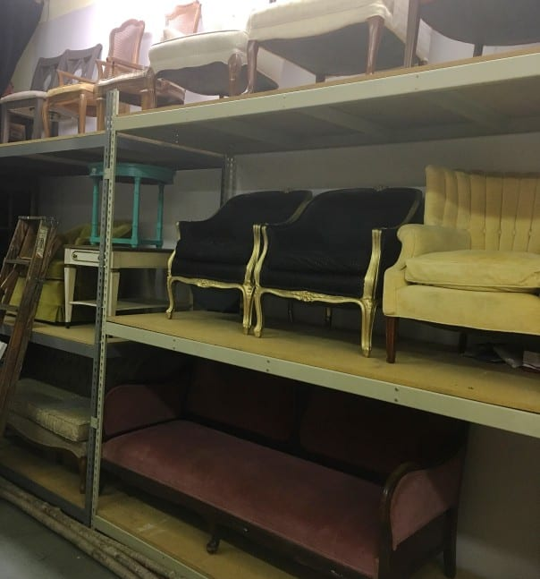 event rental storage warehouse with shelves and furniture