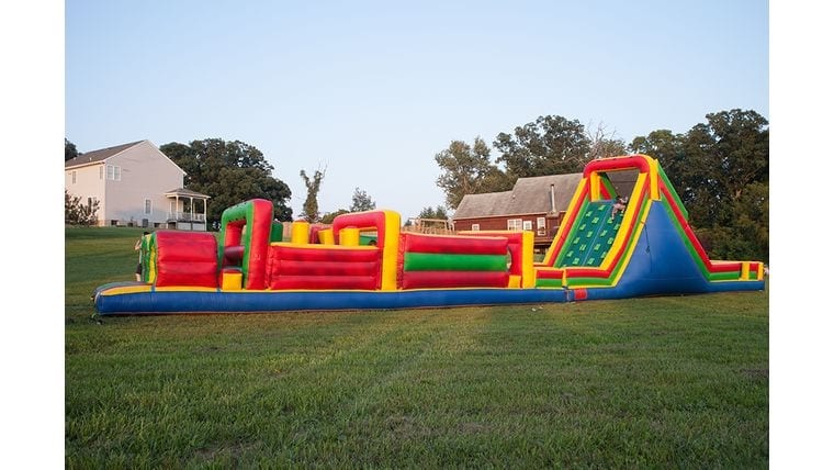 Large outdoor inflatable obstacle course at fun outdoor event