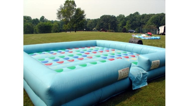 Giant inflatable twister for a birthday party, bar or bat mitzvah, or other outdoor event